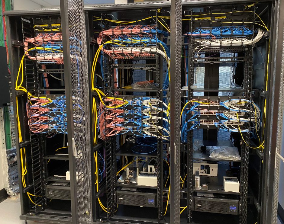 Figure 1 - A typical floor comms rack for the access layer – Cisco Stacks – Colour coded by device role